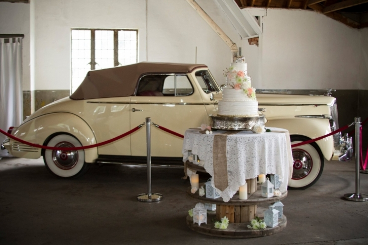 1942 cream convertible and cake