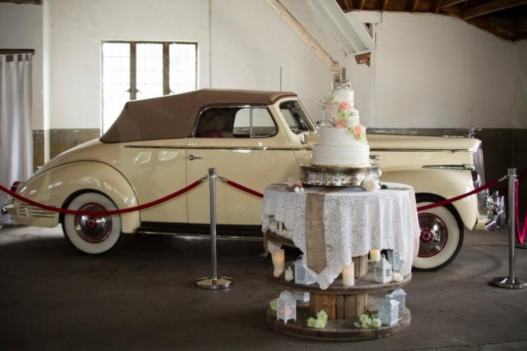 1942 cream convertible and cake